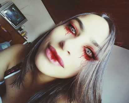 A woman with a red Halloween eye makeup look