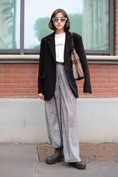 MILAN, ITALY - SEPTEMBER 22:  Nastya Burlaka ahead of the Fendi fashion show wearing Bottega Veneta ...
