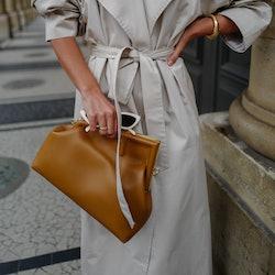 PARIS, FRANCE - SEPTEMBER 27: Füsun Lindner wearing beige The Franki Shop trenchcoat, Fendi First br...