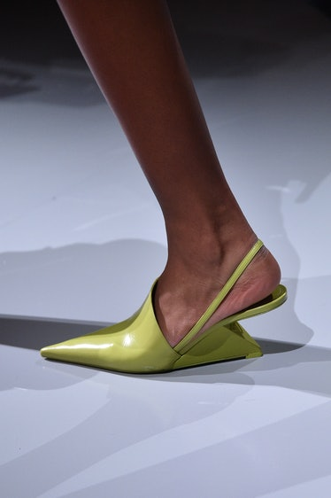 MILAN, ITALY - SEPTEMBER 24: A model, shoe detail, walks the runway at the Prada Womenswear Spring /...