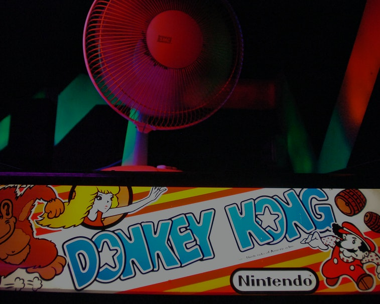 Neon fans, paint and vintage games like Nintendo's Donkey Kong fill an arcade room at Oskar Blues in...