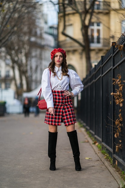 Sara Carnicella wears a beret, white shirt with puff sleeves from Victoria Tomas, and a red and blue...