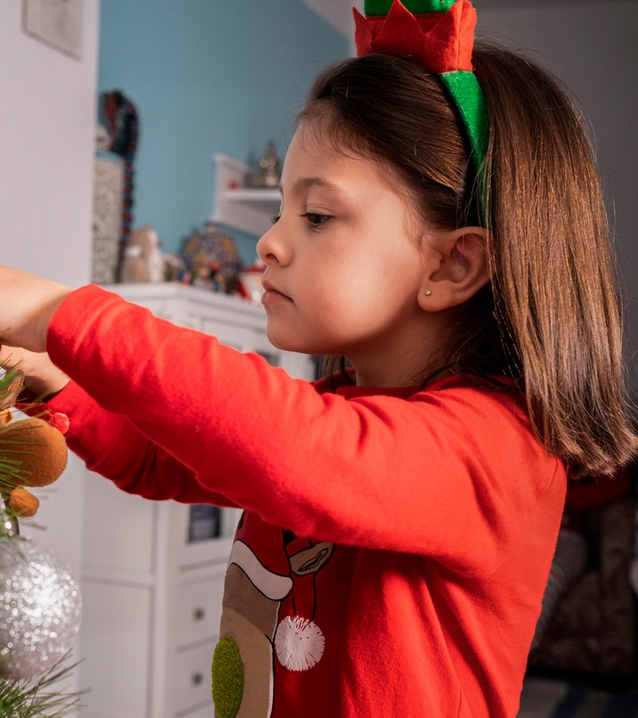profile view of girl decorating Christmas tree