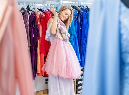 A woman shopping and choosing the right dress and coming up with ideas for a sorority formal outfit ...