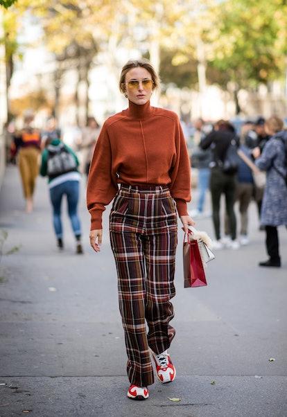 Rebecca Laurey wearing plaid pants, sneaker, knit during Paris Fashion Week.