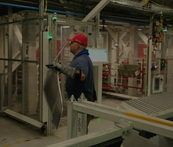A production associate works in the body line for the Tesla Model 3 at the Tesla factory on Wednesda...