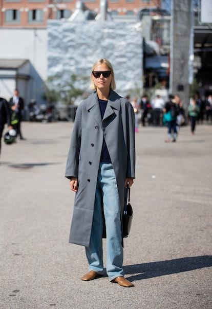 MILAN, ITALY - SEPTEMBER 24: Linda Tol seen wearing grey coat outside Sportmax during the Milan Fash...