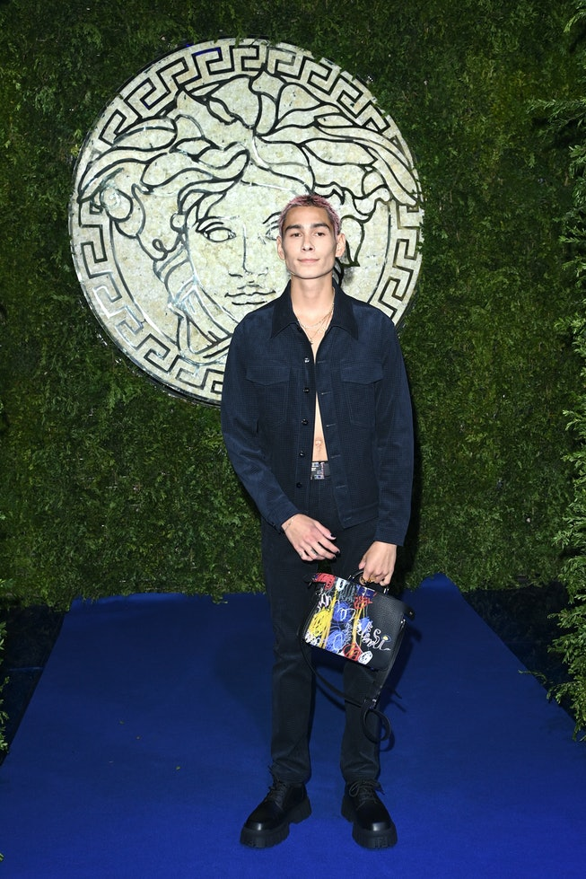 MILAN, ITALY - SEPTEMBER 26: Evan Mock is seen on the front row of the Versace special event during ...