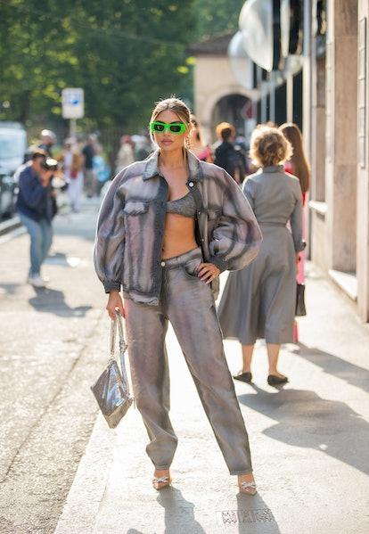 MILAN, ITALY - SEPTEMBER 22: Veronica Ferraro seen wearing jacket, pants, cropped top outside Albert...