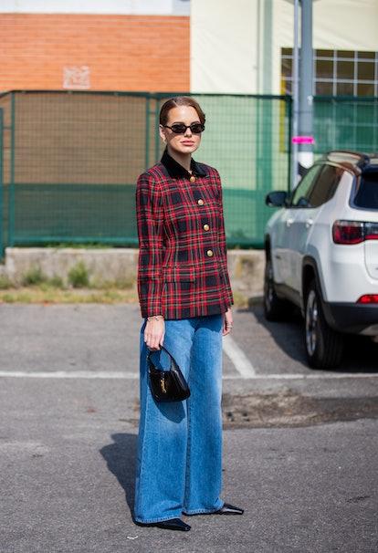MILAN, ITALY - SEPTEMBER 23: Darja Igorewna Kljukina is seen outside Boss during the Milan Fashion W...