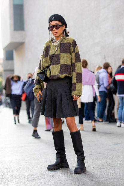 MILAN, ITALY - SEPTEMBER 23: Baya Gorbunova outside Max Mara fashion show wearing a square swater, b...