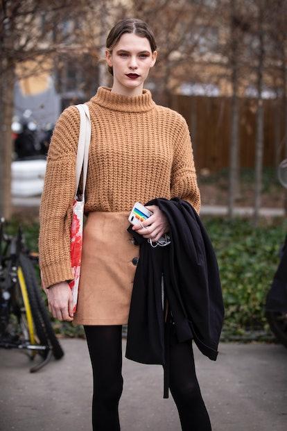A model, wearing a beige sweater and beige mini skirt, is seen outside Chloe February 28, 2019 in Pa...
