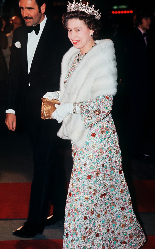 Queen Elizabeth wore a white fur stole to a movie premiere.