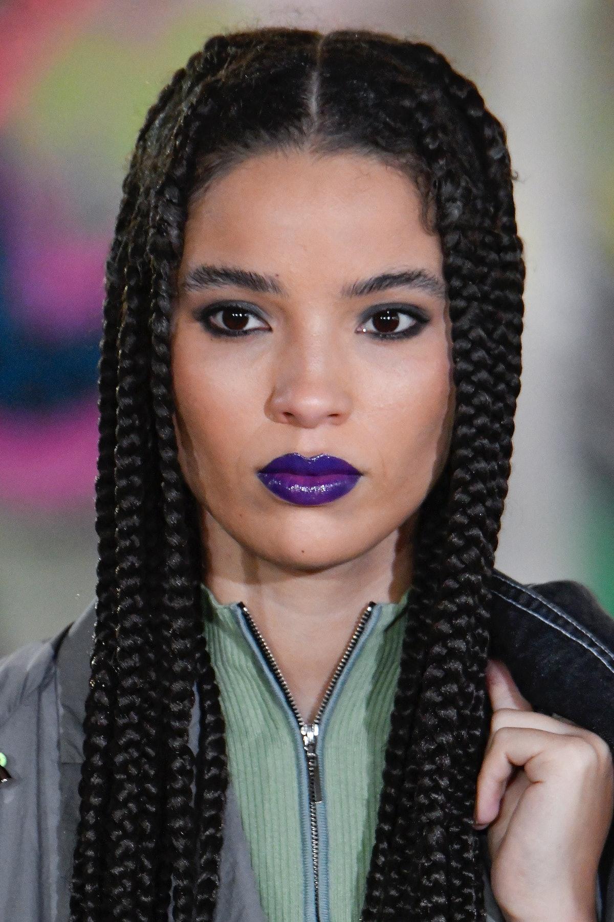 At Mark Fast, MUA Pablo Rodriguez painted models' lips a glossy violet-slash-indigo color — specific...