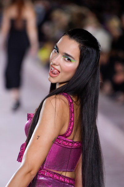 MILAN, ITALY - SEPTEMBER 24: Dua Lipa walks the runway at the Versace fashion show Spring Summer 202...
