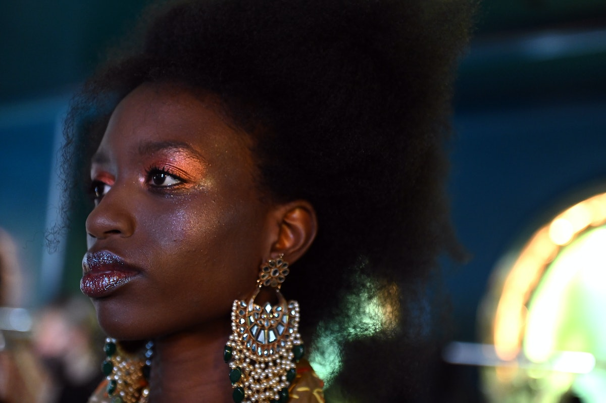A model backstage ahead of the OSMAN  show during London Fashion Week September 2021 on September 20...