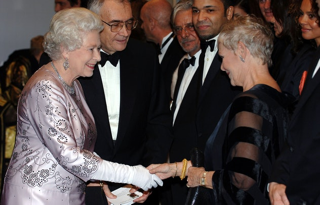 Queen Elizabeth chats with Dame Judi Dench.
