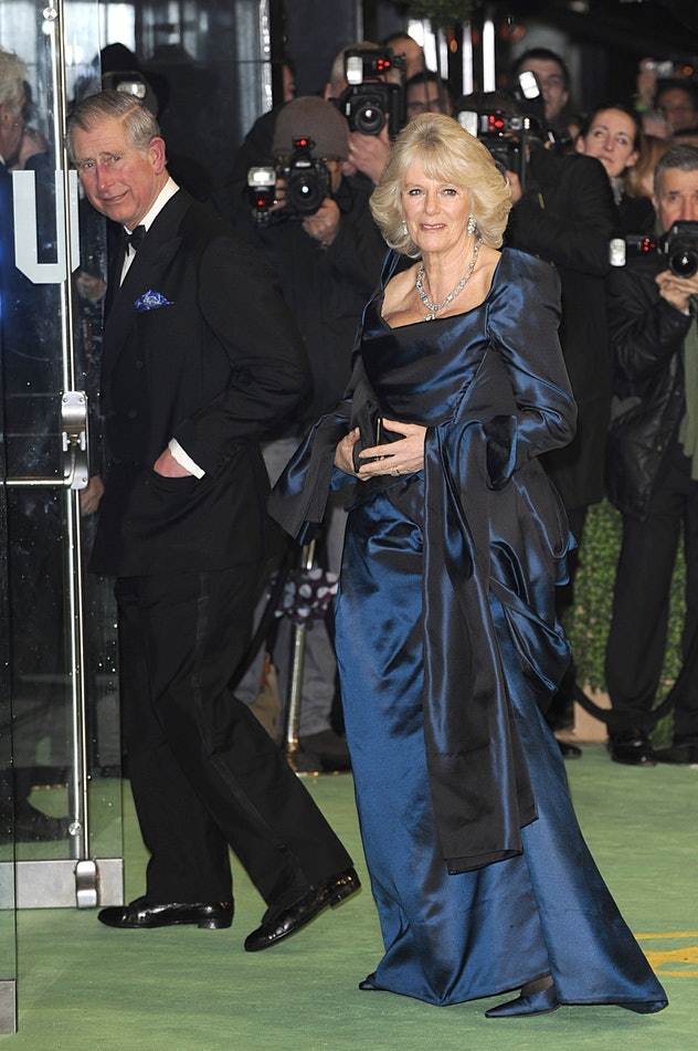 Prince Charles and Camilla Parker-Bowles attend a movie premiere.