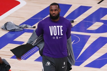LAKE BUENA VISTA, FLORIDA - OCTOBER 09: LeBron James #23 of the Los Angeles Lakers wears a VOTE shir...
