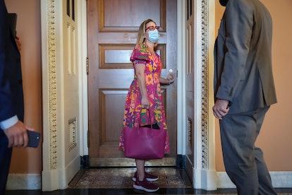 WASHINGTON, DC - SEPTEMBER 28: Sen. Kyrsten Sinema (R-AZ) arrives for a lunch meeting with Senate De...
