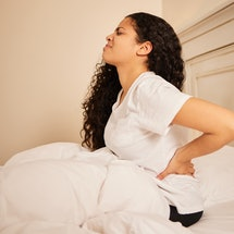 Experts share tips for how to sleep with back pain.