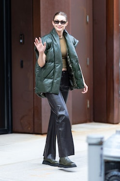 Gigi Hadid wears oversized leather puffer vest from FRAME and Wandler Rosa boots while out and about...