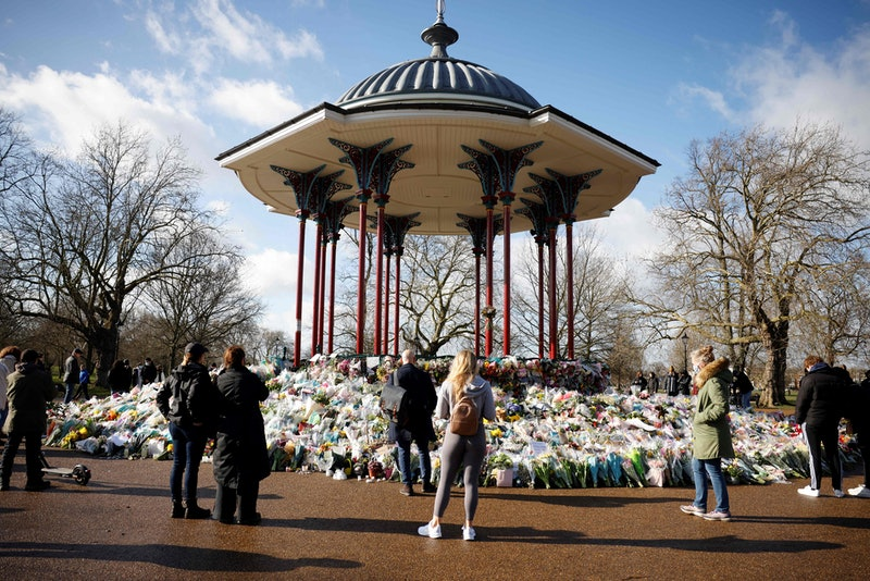 Well-wishers reflect alongside floral tributes in honour of Sarah Everard, the missing woman whose r...