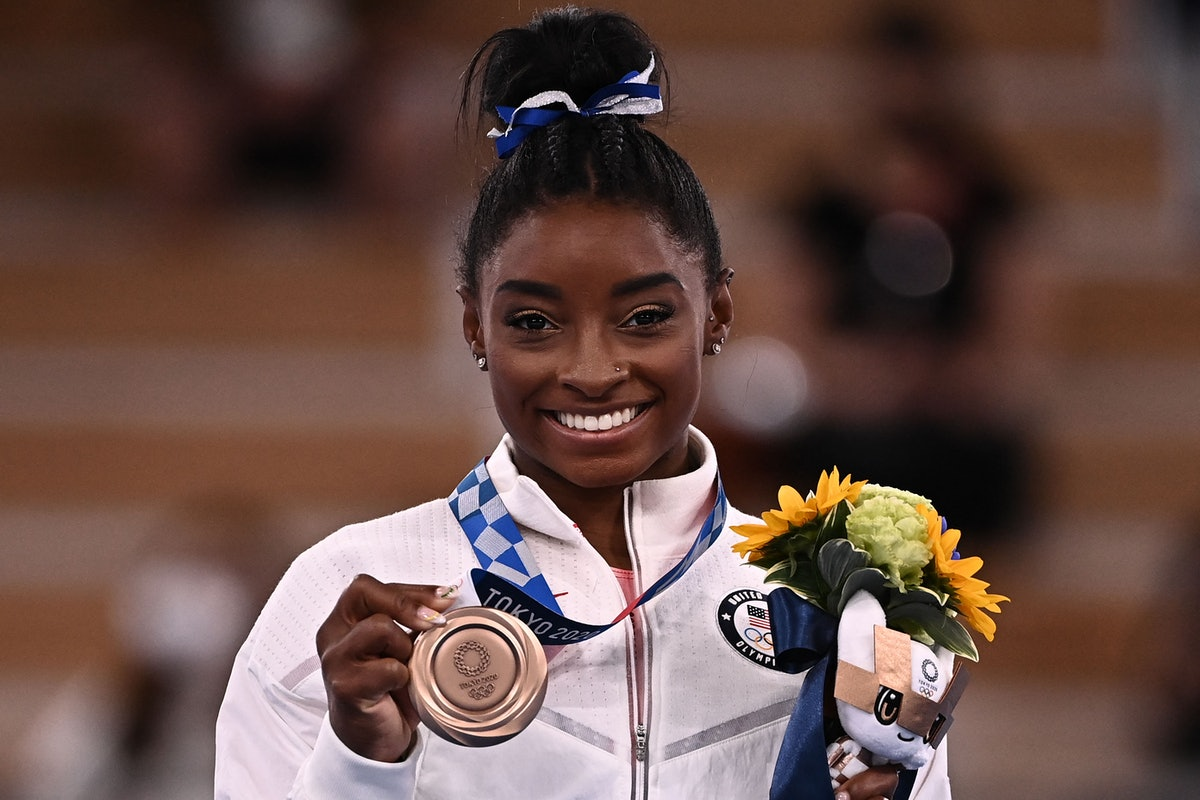 Simone Biles posted a blunt Instagram note addressing haters calling her a quitter.