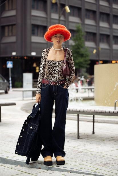 STOCKHOLM, SWEDEN - SEPTEMBER 01: Emma Fridsell wearing, dark navy blue jeans, denim jacket, leopard...