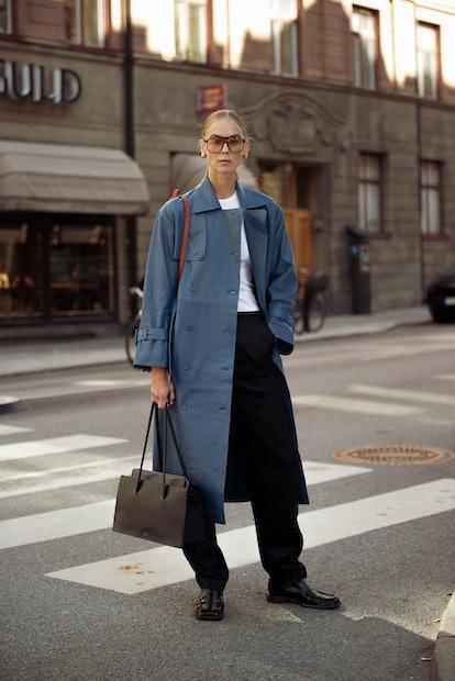STOCKHOLM, SWEDEN - AUGUST 31: Hilda Sandstrom wearing black pants, white top and blue coat outside ...