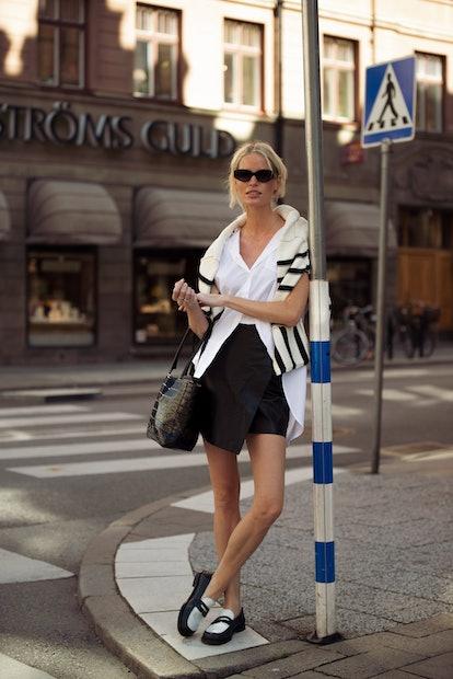 STOCKHOLM, SWEDEN - AUGUST 31: Caroline Winberg wearing black skirt, white shirt, striped black and ...