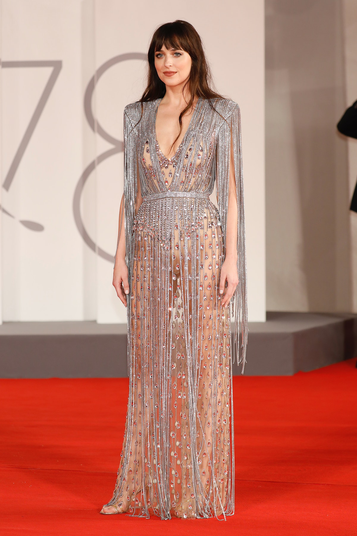 Dakota Johnson arrives on the red carpet for 'The Lost Daughter' during the 78th Venice Internationa...