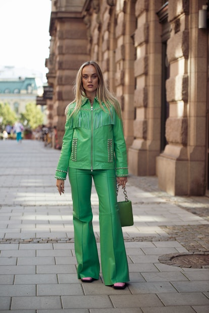 STOCKHOLM, SWEDEN - AUGUST 31: Amanda Winberg wearing green leather suit with metal details and gree...