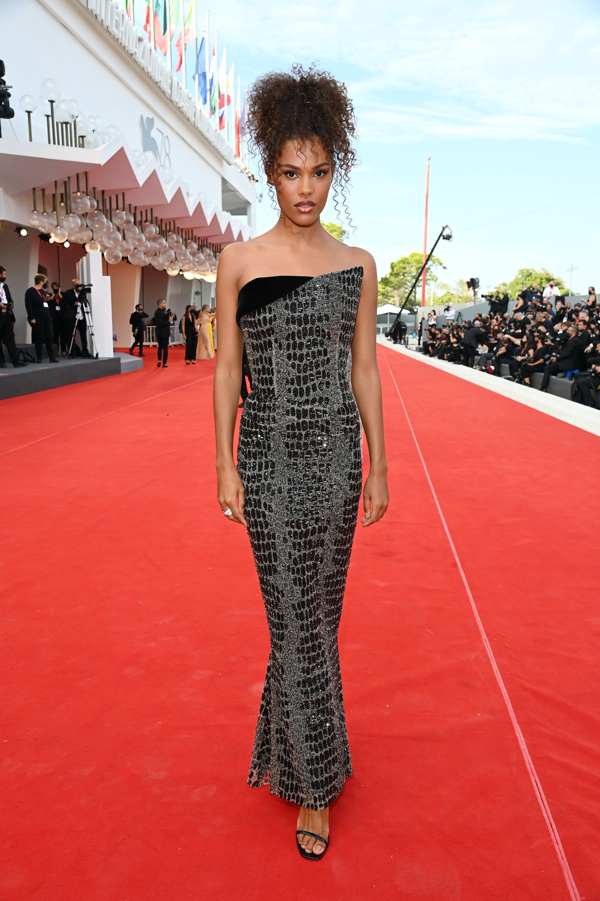 """VENICE, ITALY - SEPTEMBER 03: Tina Kunakey attends the red carpet of the movie """"Dune"""" during the 78t..."""