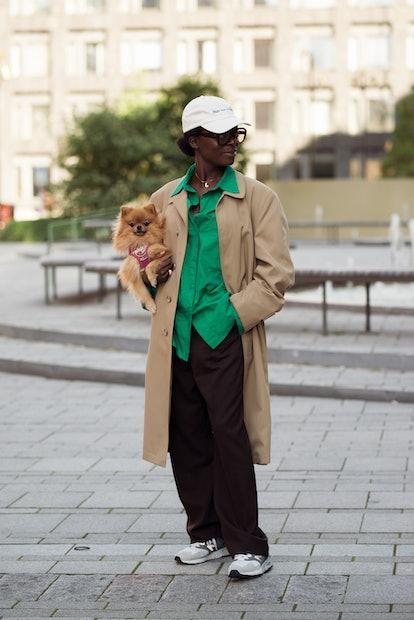 STOCKHOLM, SWEDEN - SEPTEMBER 02: Chrystelle Eriksberger wearing black pants, green shirt and beige ...