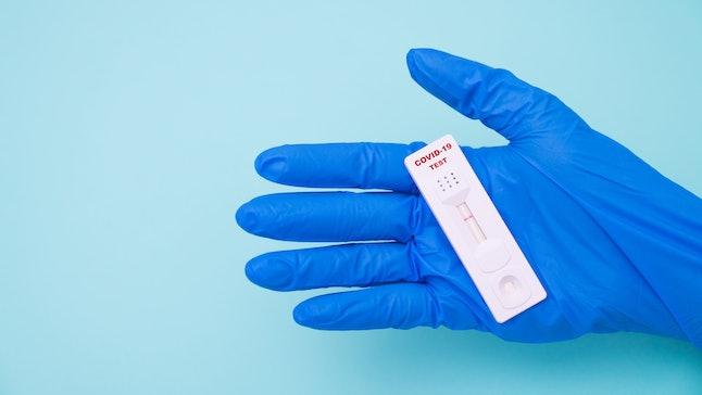 Doctor holding a test kit for viral disease COVID-19 2019-nCoV. Lab card kit test for viral novel co...