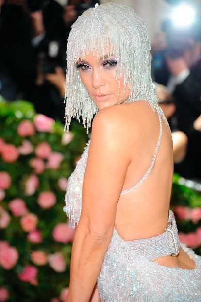 For 2019's Camp-themed Met Gala, J.Lo wore a silver beaded and sequined wig.