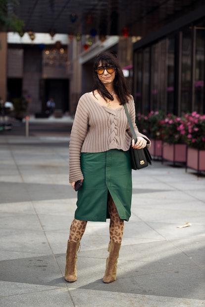 STOCKHOLM, SWEDEN - AUGUST 31: Susan Stjernberger wearing brown boots, animal print tights , green l...