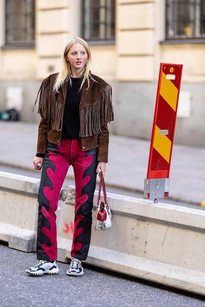 STOCKHOLM, SWEDEN - SEPTEMBER 01: Ingrid Berg wearing a vintage jacket and her own Iggy jeans poses ...