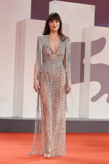 """VENICE, ITALY - SEPTEMBER 03:  Dakota Johnson attends the red carpet of the movie """"The Lost Daughter..."""