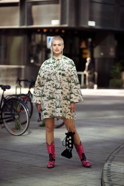 STOCKHOLM, SWEDEN - AUGUST 31: Cajsa Wessberg wearing Baum und Pferdgarten dress, pink cowboy boots,...