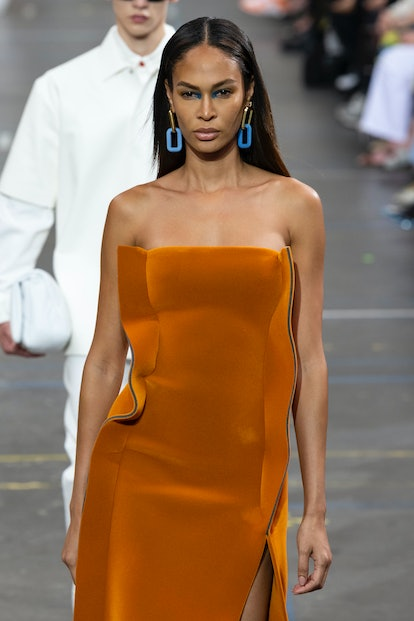 A top fall 2021 makeup trend: Joan Smalls at OFF-WHITE Fall Winter 2021 with bright inner corner eye...