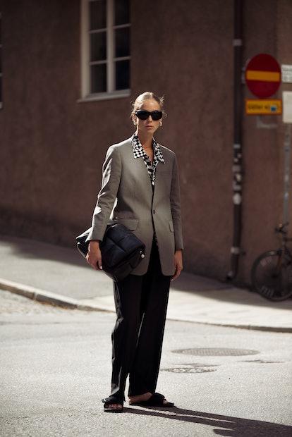 STOCKHOLM, SWEDEN - SEPTEMBER 02: Hilda Sandstrom wearing black pants, white and black checked shirt...