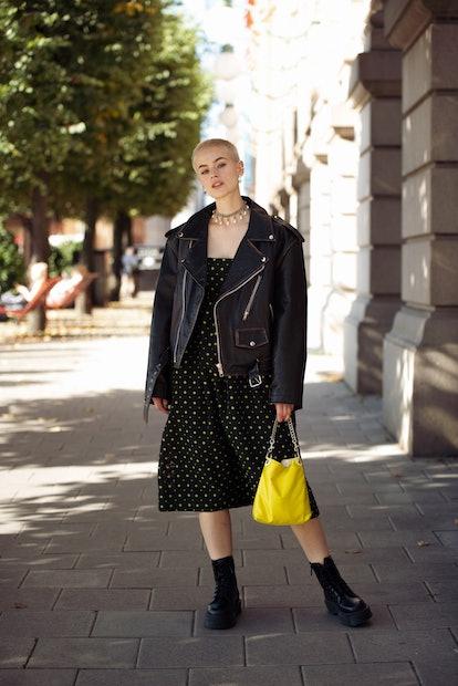 STOCKHOLM, SWEDEN - AUGUST 31: Cajsa Wessberg wearing black dress with green pattern, black oversize...