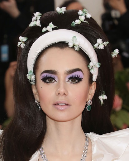 Lily Collins attends the 2019 Met Gala wearing '60s-era mod makeup.