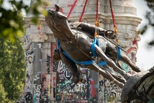 EDITORS NOTE: Graphic content / The statue of Confederate General Robert E. Lee is removed from Monu...