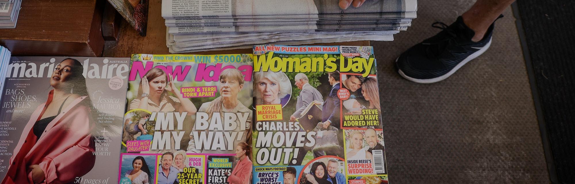 SYDNEY, AUSTRALIA - APRIL 10: A customer at a newsagent picks up an Australian newspaper reporting o...