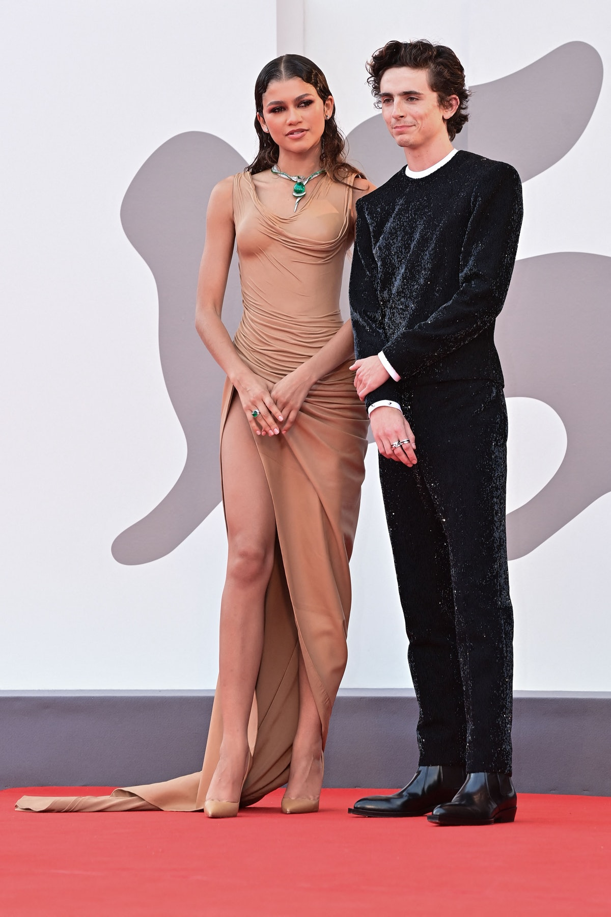 """US actress Zendaya and French US actor, Timothee Chalamet arrive for the screening of the film """"Dune..."""