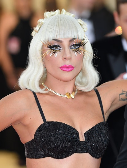 Lady Gaga's Met Gala Camp makeup look featured false lashes and a bold pink lip.