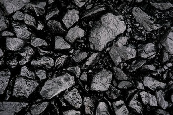Gray or black gravel or crushed stone for road construction and reconstruction, poured with bitumen....